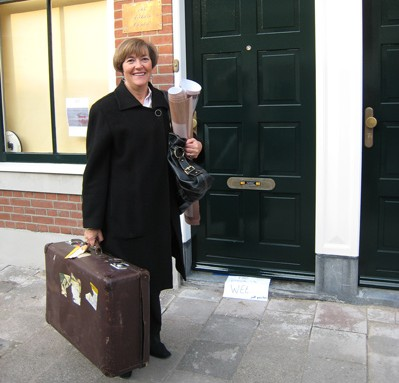 Glenda Lewin and suitcase outside the EAC